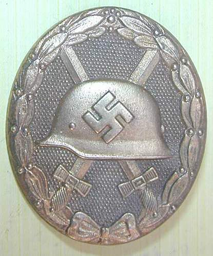 Click image for larger version.  Name:ww2 wound badge gold 1.jpg Views:241 Size:48.3 KB ID:439508
