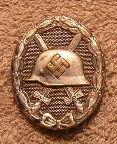 Click image for larger version.  Name:wound badge.jpg Views:33 Size:171.3 KB ID:50808