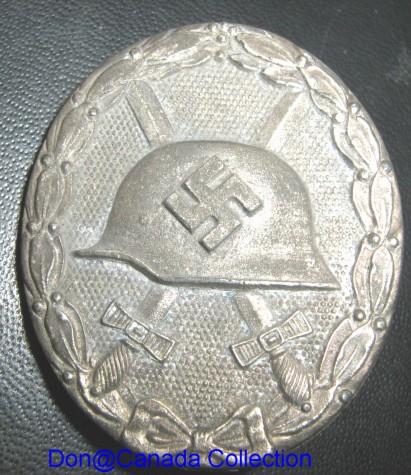Silver l/12 wound badge???????