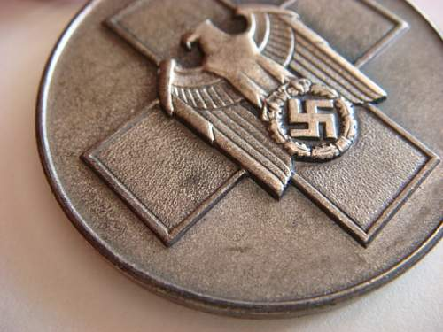 Verwundetenabzeichen and medal - need opinion