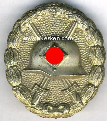 Original early silver wound badge?