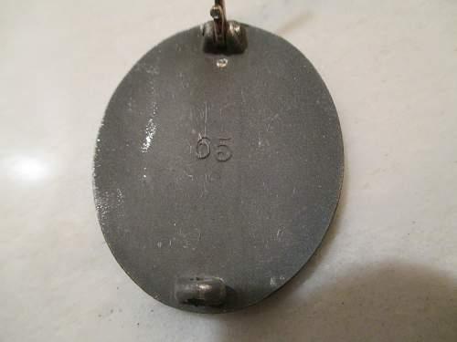Verwundetenabzeichen #65 in Silber with bottom of case