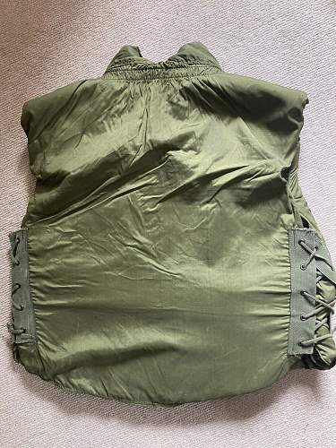 Does this look like a repro m69 flak vest with old labels on it?