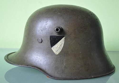 Infantry Regiment 6: M18 Helmet and photo album.
