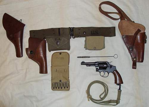 Unissued WWII Victory .38 Special Pistol with a grouping of web gear, holsters and accessories.