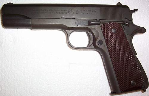 My Cherry WWII Colt 1911A1 Pistol which is the centerpiece of my WWII weapons collection