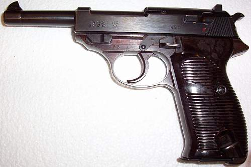 A mint WWII Walther AC 42  P-38 Pistol with an extremely early serial number and plum colored frame