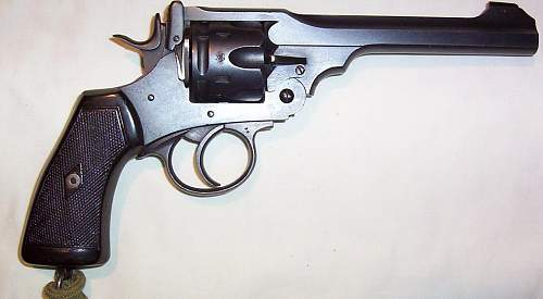 A nice 1917 dated, Webley Mark VI, top break revolver, but with turned down cylinder. Boo Hoo!