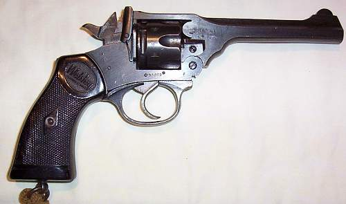A couple of really nice British WWII .38 revolvers and accessories