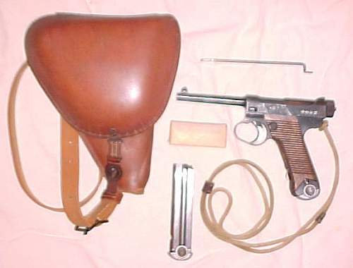 The Triple Crown of Japanese Military WWI/WWII pistols and accessories. Type 26, 14 and 94.