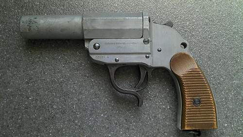 Walther M34 Zinc flare gun with wood grips.