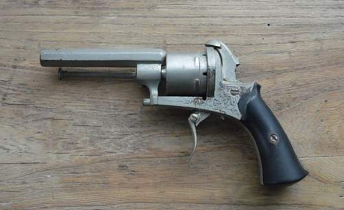 Old pistol and powder flask