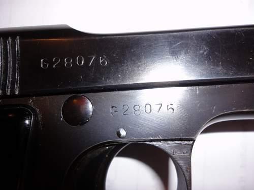 I need help identifying this WW2 Pistol