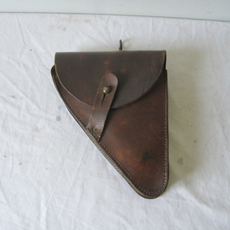 Help needed identifying a leather holster with brass hooks.