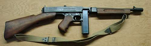 Click image for larger version.  Name:Thompson M1928A1 and M1A1 carbine. - Copy.JPG Views:7636 Size:121.8 KB ID:68563