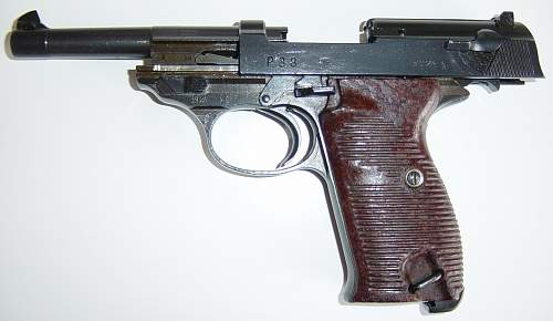 Click image for larger version.  Name:Walther P38 with open slide..JPG Views:9868 Size:179.5 KB ID:7411
