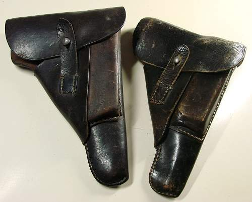 Click image for larger version.  Name:Two 1943 dated P.38 soft shell holsters..JPG Views:650 Size:225.3 KB ID:84394