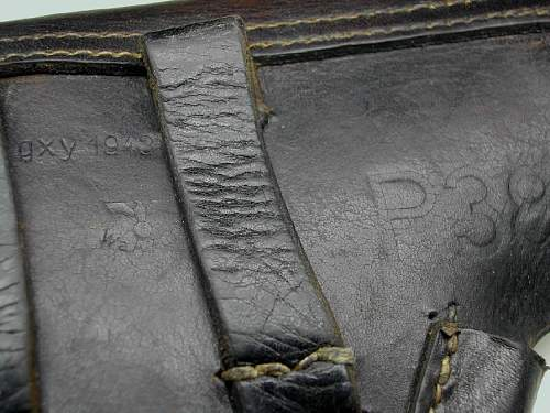 Click image for larger version.  Name:Rear markings on 1943 P38 holster gxy WaA706.jpg Views:520 Size:110.8 KB ID:84395