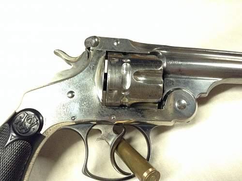 WW2 1911, plus spainish American war revolver?