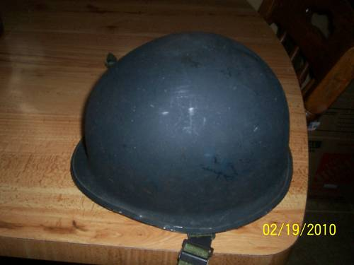 seller claims a Belgian police helmet is USN issue