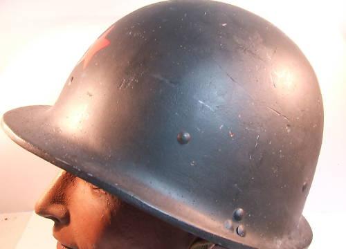 unusual fiber type helmet with red star?