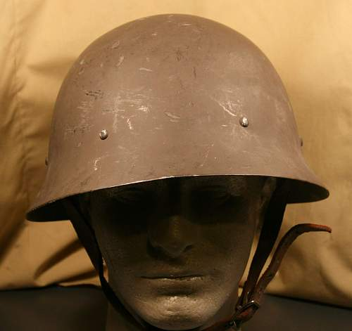 I  am ask ing for help to identify this helmet please?