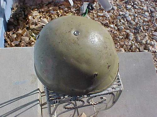 very crude M1 style helmet with Polish Wz50 liner , possibly an IRAQI helmet?