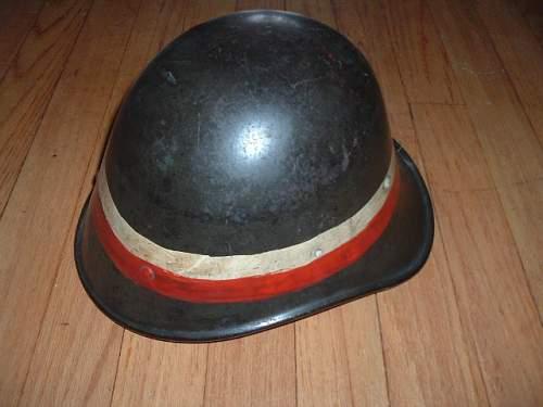 Assorted reissue Polish Fire Helmets