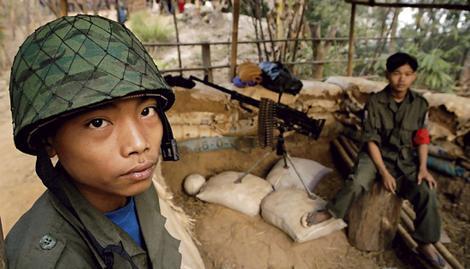 Burmese soldier wearing a Chinese made helmet