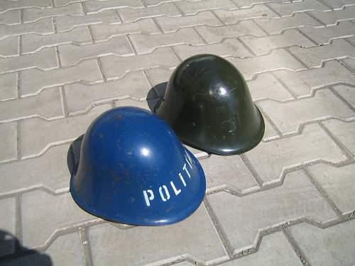 Two helmets: Romanian & Russian