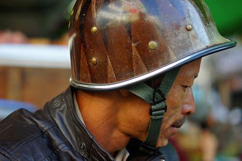 unusual M1 helmet liner modified for motorcyclist in Vietnam