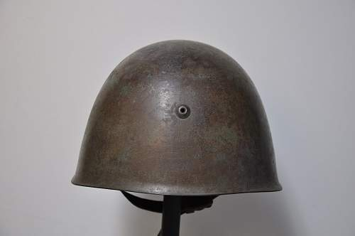 Is this Italian M33 helmet WW2 Original? Need info!