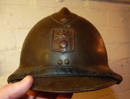Can someone identify this helmet and it's origin?