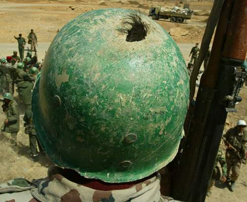 unusual green painted US mfg M1 helmet liner with foreign headband?