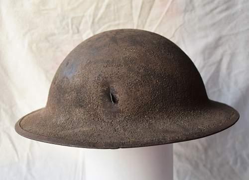 USA great war helmet with shrapnel splinter damage and flash