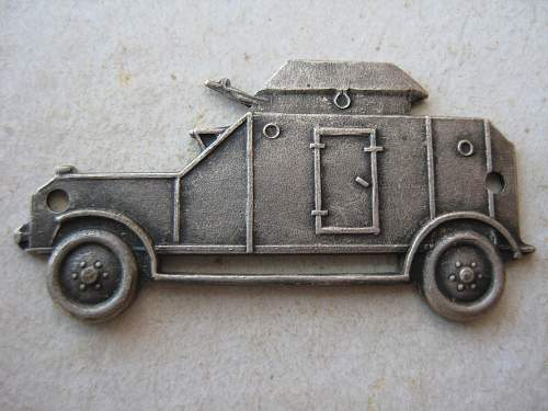 What are these T and Armoured Car badges ?