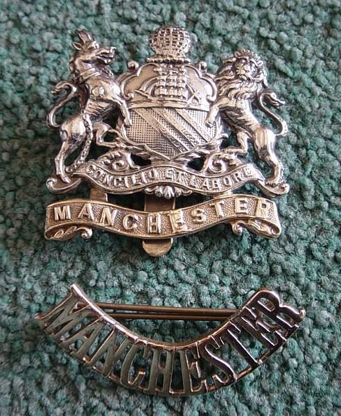 Click image for larger version.  Name:Manchester Regt cap badge and shoulder title. Pre 1923.jpg Views:561 Size:245.5 KB ID:18453