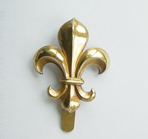 Manchester Regt cap badge and shoulder title