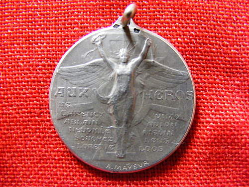 French? Aux Heros Medal.