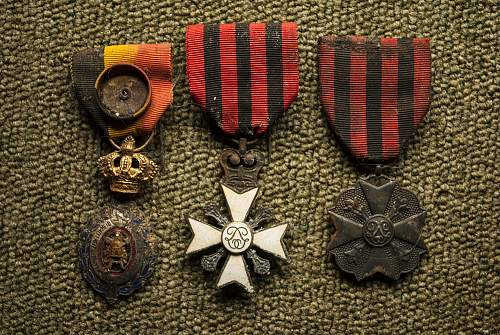 Click image for larger version.  Name:FoundMedals.jpg Views:164 Size:147.6 KB ID:411491