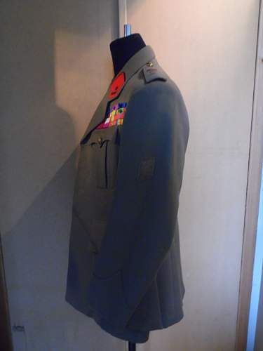 Belgian mod 1935 officers uniform and trench coat of a WWI soldier.