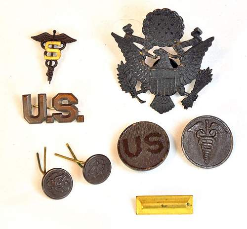 US Cap & Uniform Insignia