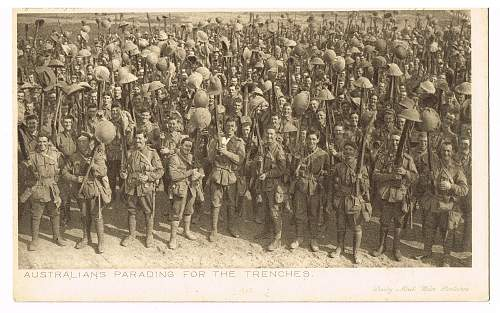 Australian troops with camo helmet covers etc picture