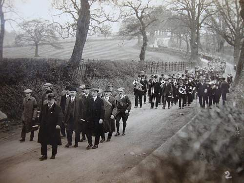 ww1 era large march with black armbands